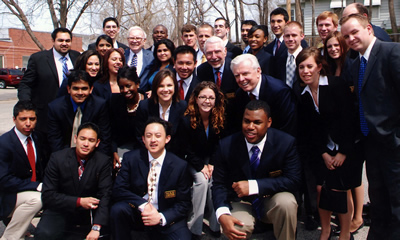 WCE students, staff and faculty with Warren Buffett